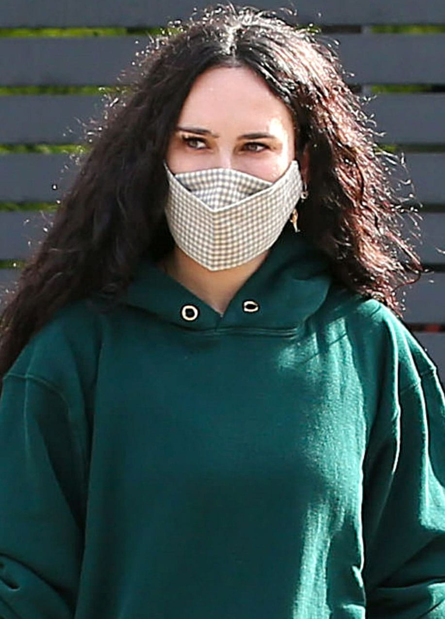 Rumer Willis wears her long, natural curly hair down and stays protected with a plaid face mask