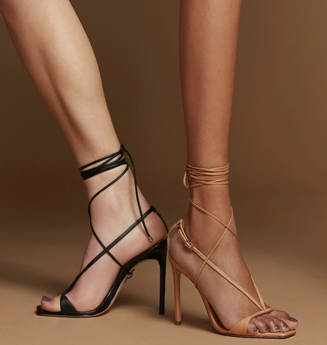 These twisted strap sandals are available in black and honey beige