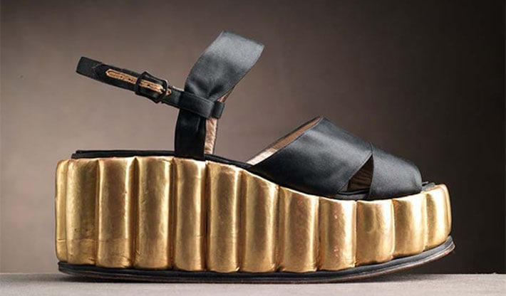 This satin sandal with sculpted kidskin-covered cork platform is just one of the first few wedge shoes designed by Salvatore Ferragamo in the 1940's