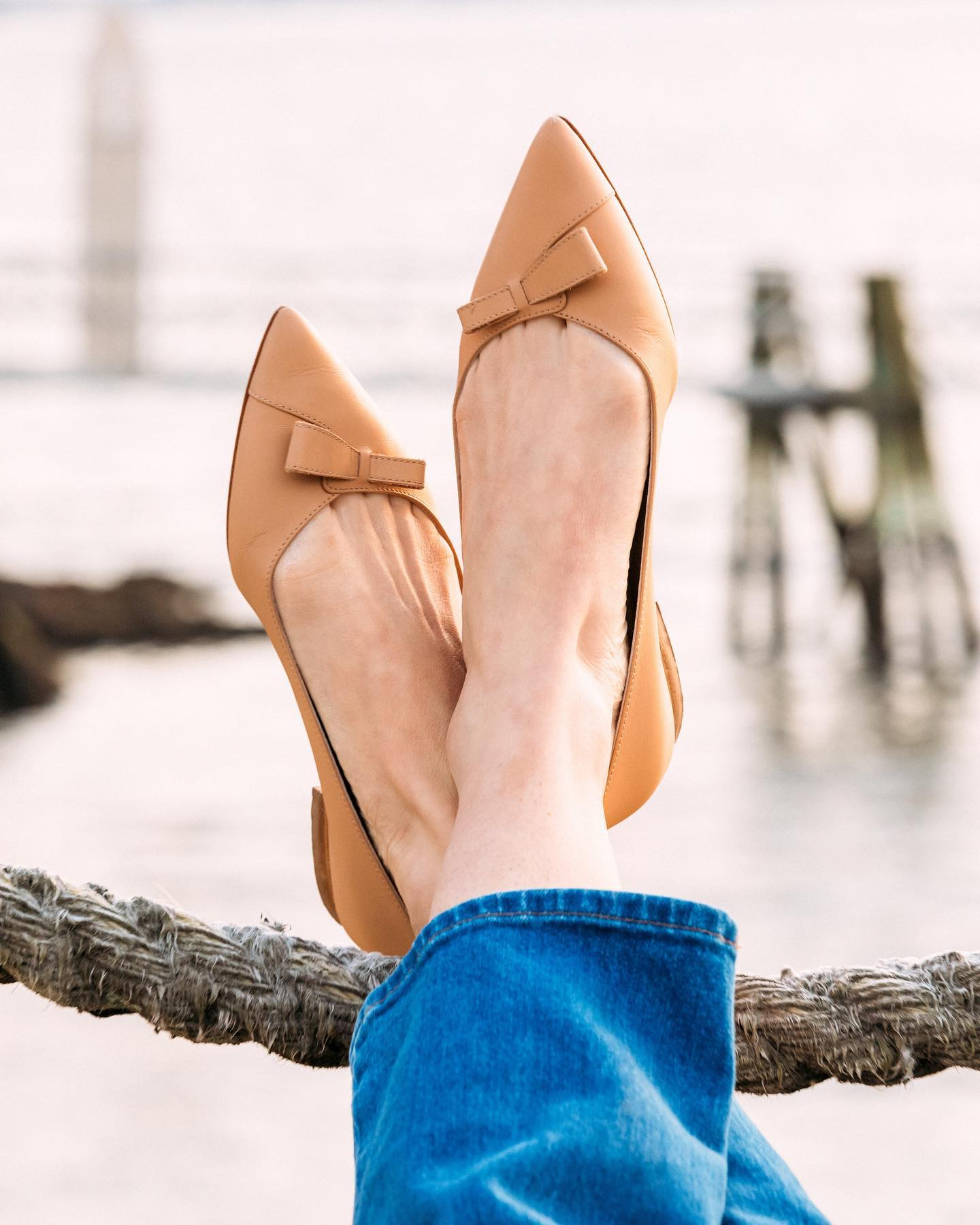 Sarah Flint's Italian-handcrafted Natalie flats provide luxurious comfort with a stylish asymmetrical bow and about 0.4-inch heels