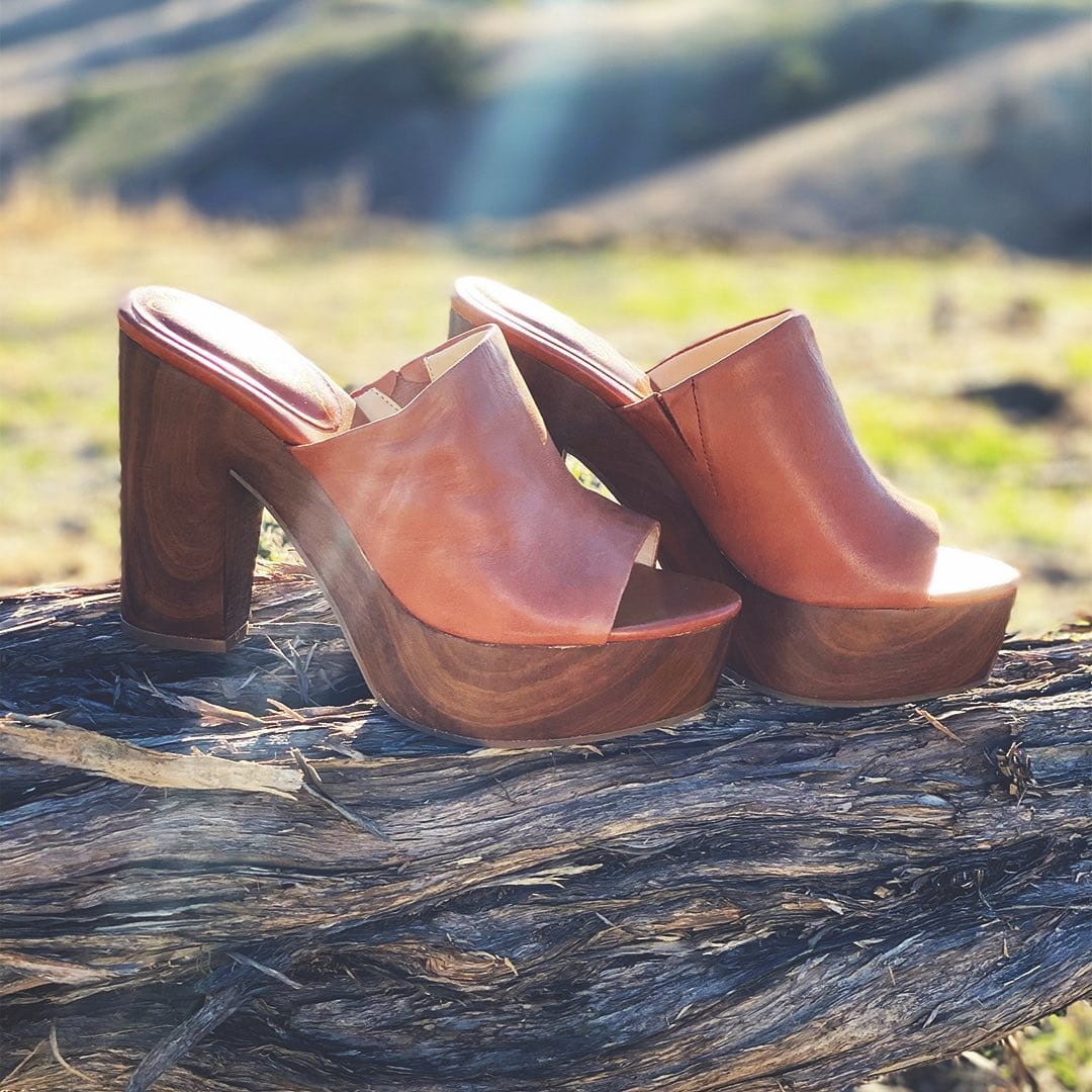 These caramel mules are designed with a chunky platform that lends the retro slip-on a 70s feel