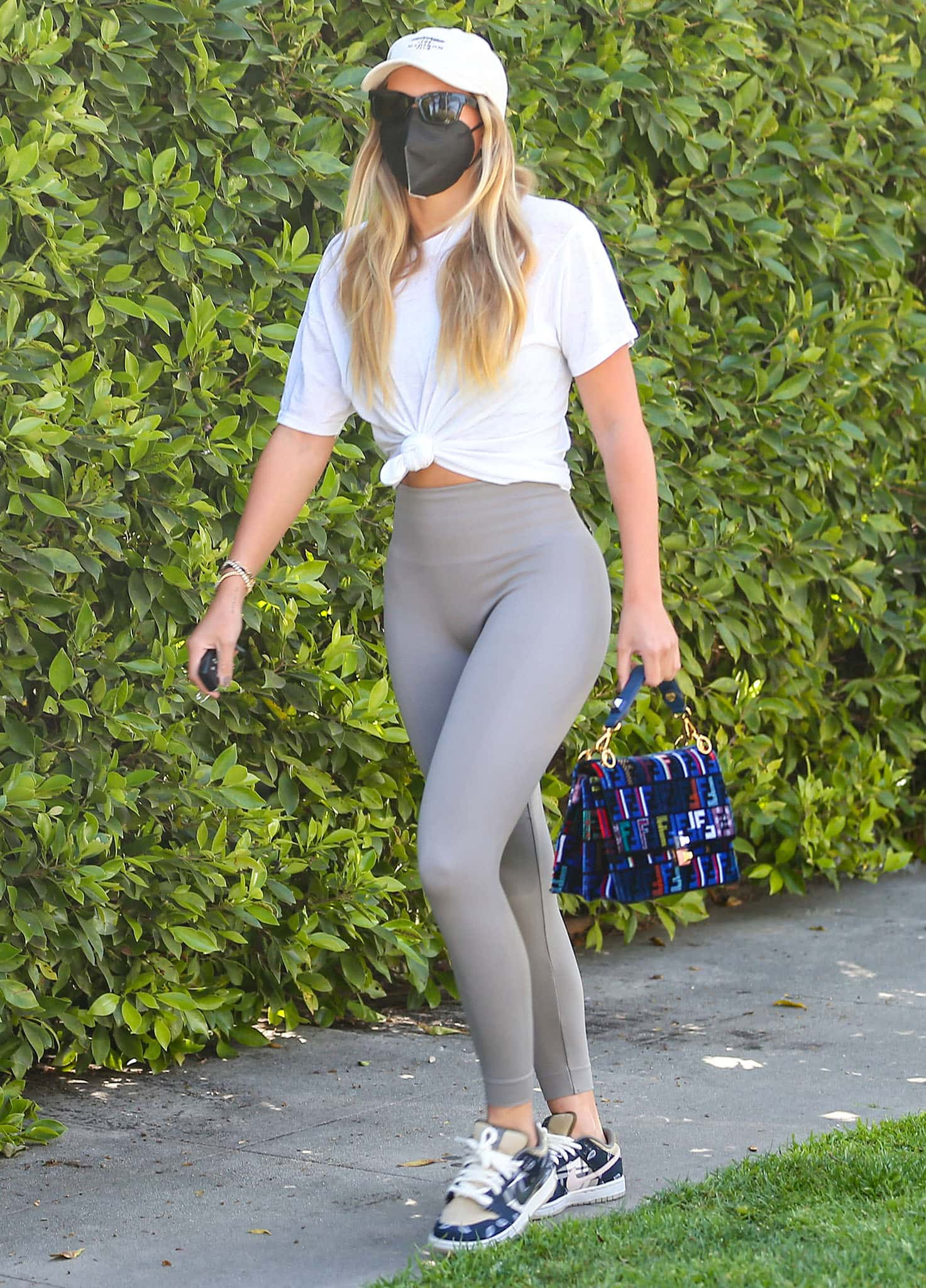 Sofia Richie shows off her figure in knotted white tee and Set Active x Madelyn Cline leggings