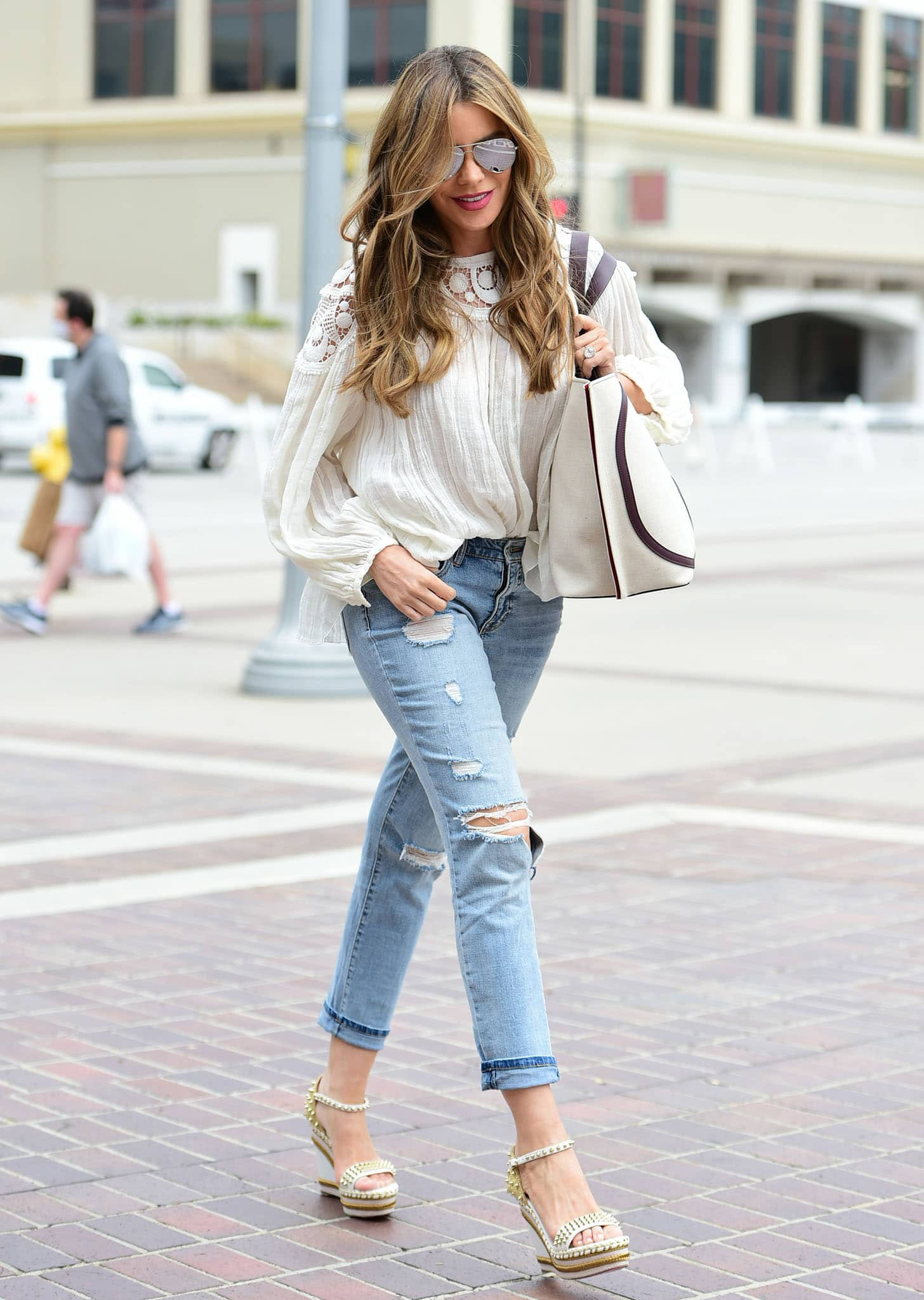 Sofia Vergara flaunts her shapely legs in Sofia Jeans boyfriend jeans and a white chiffon blouse at America's Got Talent studios