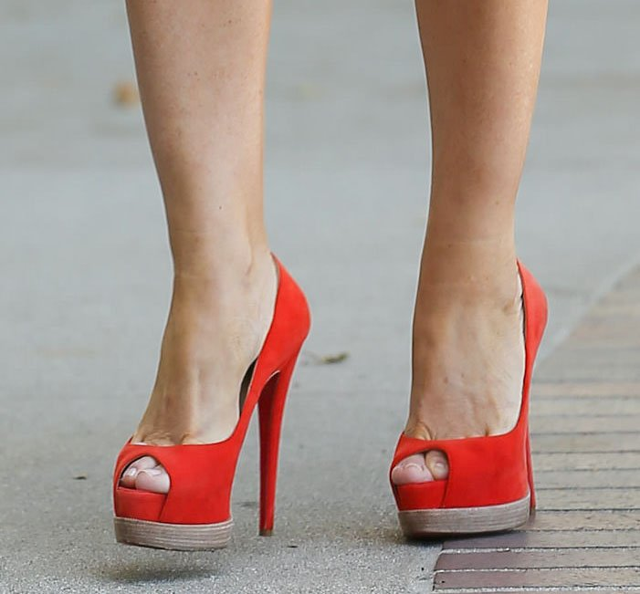 Sofia Vergara shows off her feet in red-orange peep-toe stiletto pumps