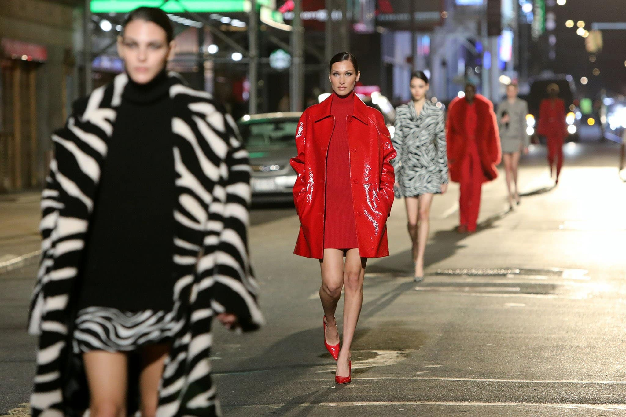 Supermodels hit the New York City street in Michael Kors' latest outfit designs