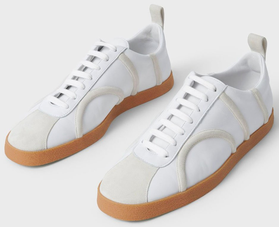 Suede trims and toe panelling add a contemporary design to Toteme's The Sneaker leather shoes