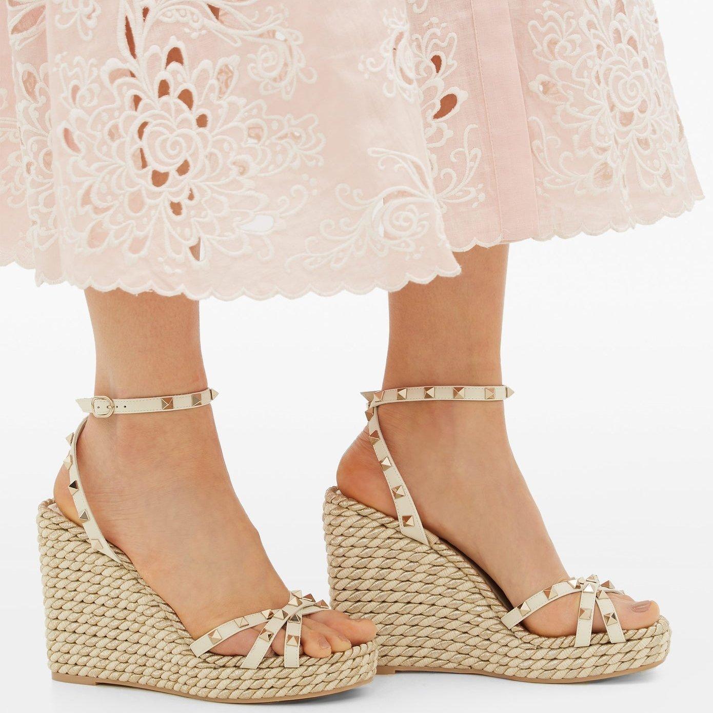 Valentino Garavani's gold Torchon sandals worn with Zimmermann's pale-pink Freja shirt dress