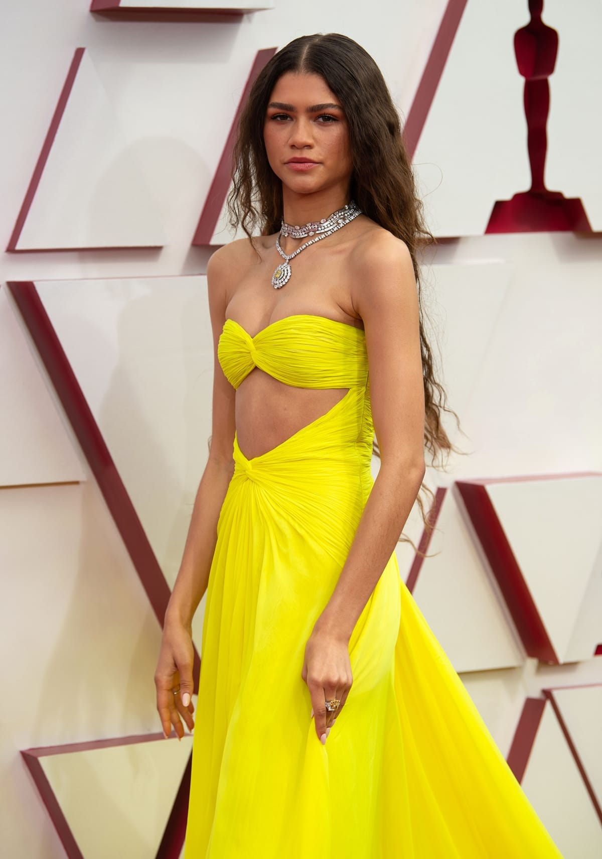 Zendaya in a yellow Valentino dress attends the 93rd Annual Academy Awards