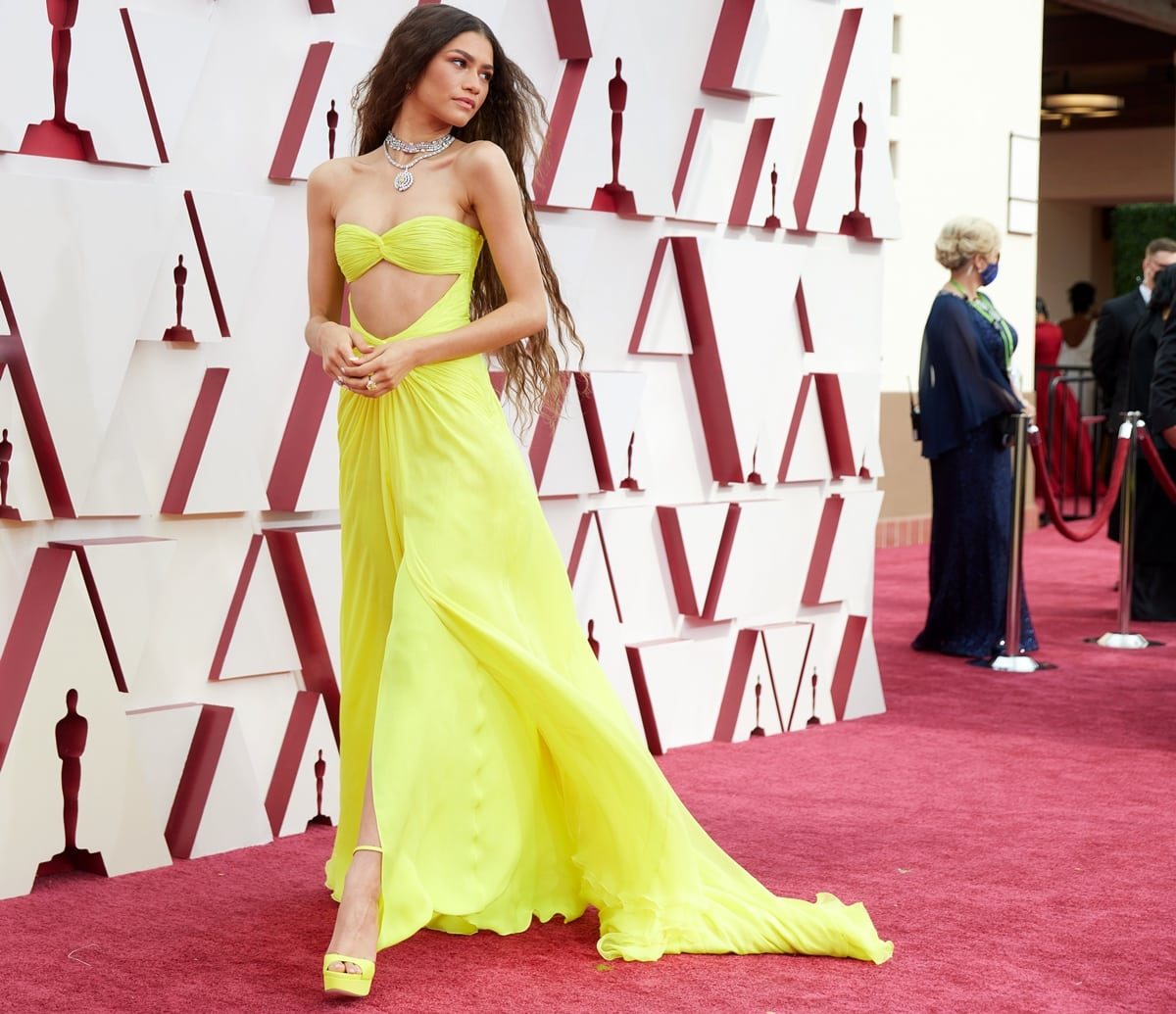 Zendaya wore a bright yellow strapless gown that glows in the dark