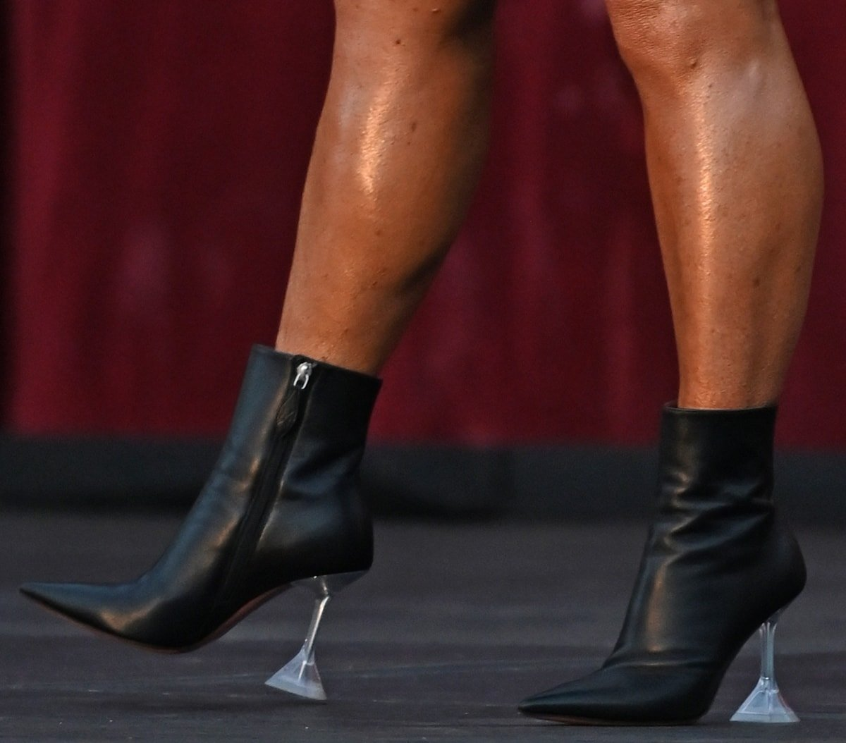 Theresa Caputo wears pointy toe ankle-high buffed leather boots from Amina Muaddi