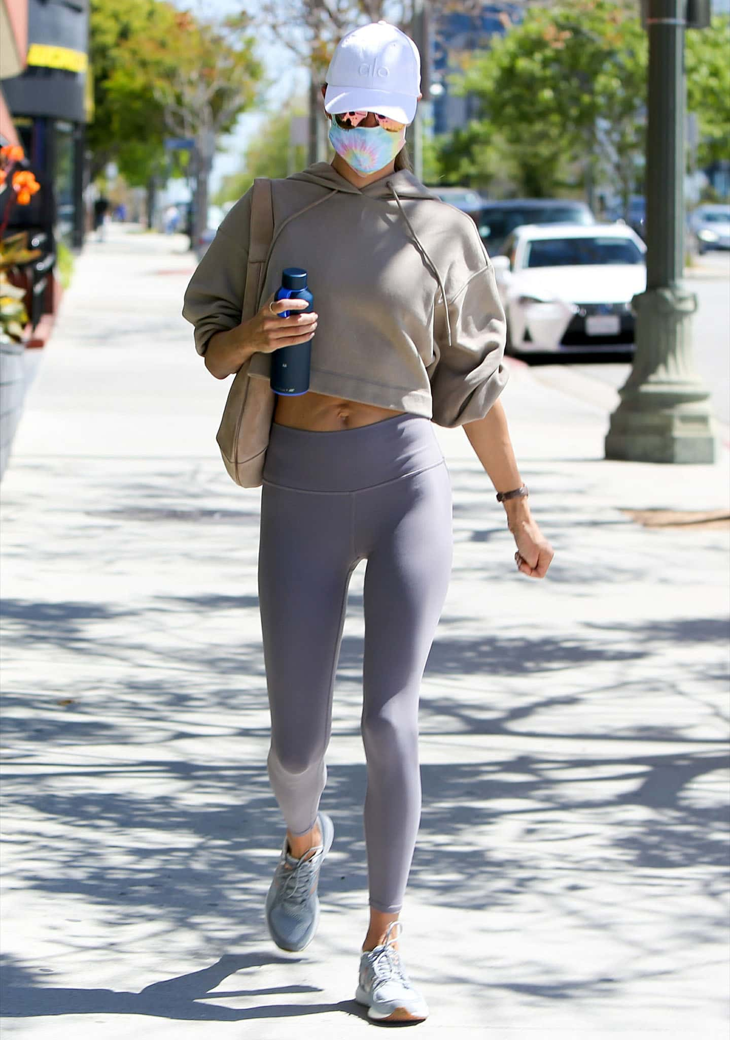 Alessandra Ambrosio covers up with a taupe-colored Alo Yoga Bae cropped hoodie
