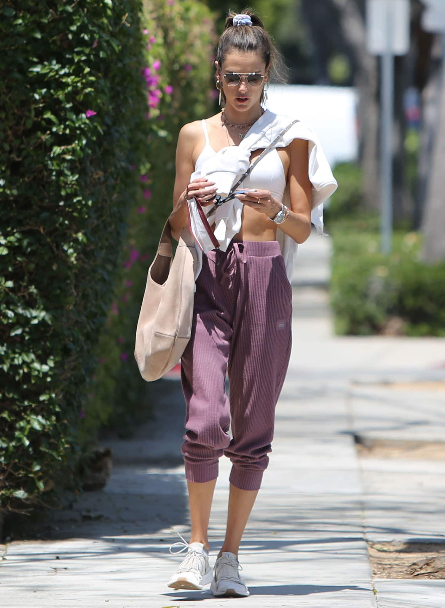 Alessandra Ambrosio heads to Pilates class in Alo Yoga bralette and ribbed sweatpants on May 4, 2021