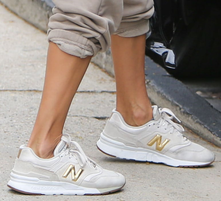 Alessandra Ambrosio pairs her athleisure with New Balance 997H white/gold shoes
