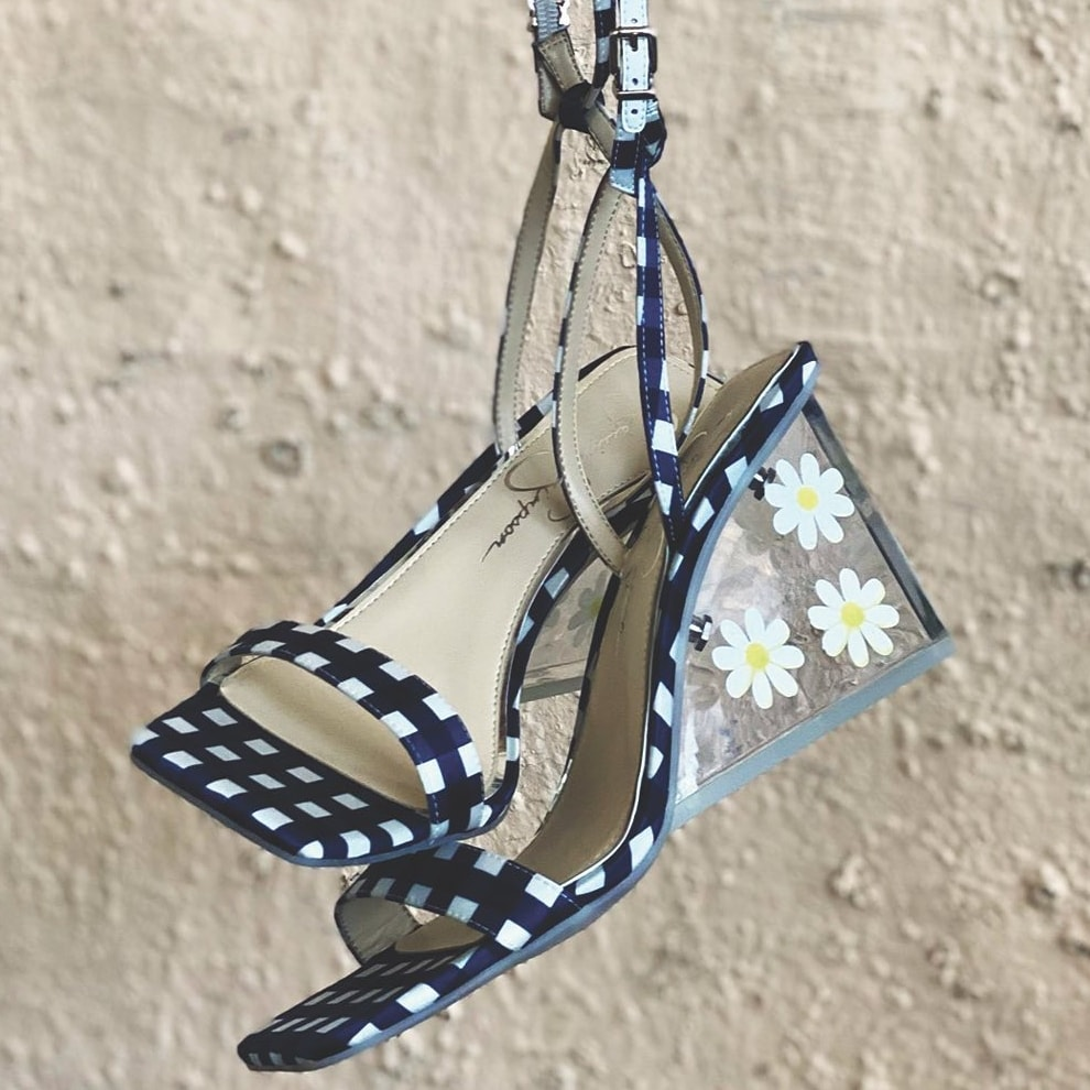 Navy blue ankle-strap sandal featuring gingham print with a translucent wedge brightened by daisies