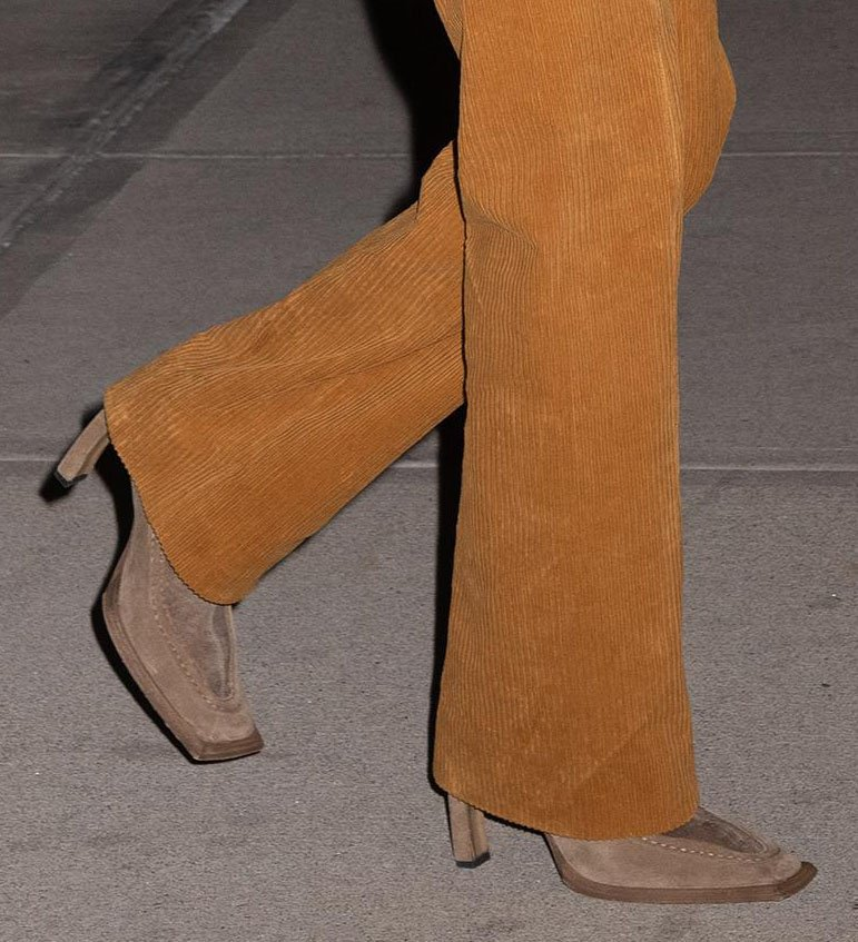 Bella Hadid teams her retro outfit with brown suede square-toed boots
