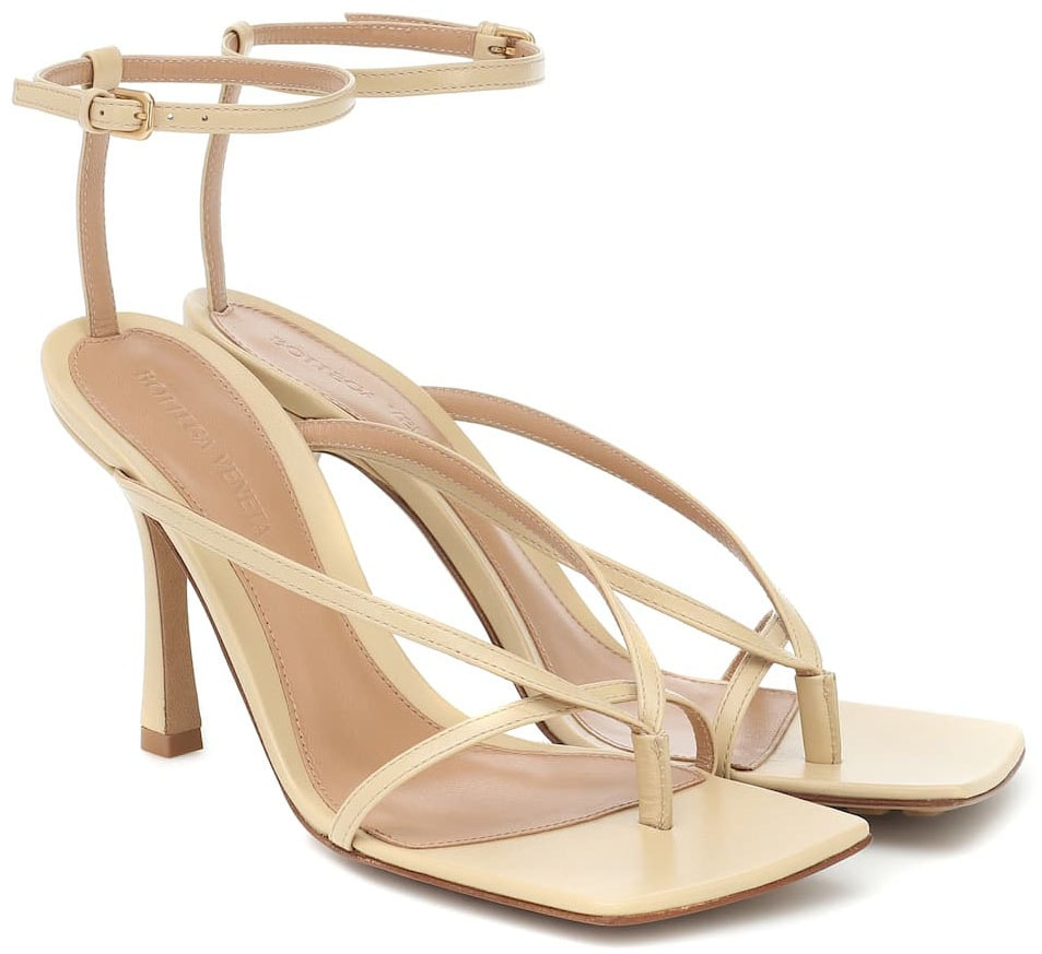 A minimalist pair of sandals with trendy square toes and sculpted heels