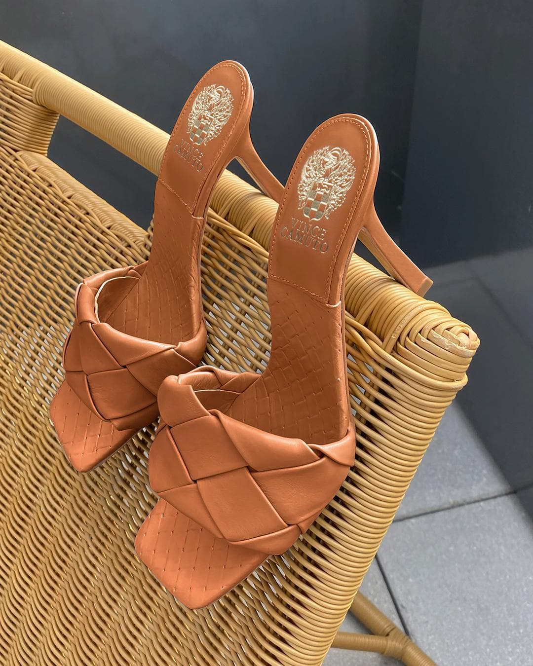 This barn brown woven-strap mule crafted of buttery, basketweave leather