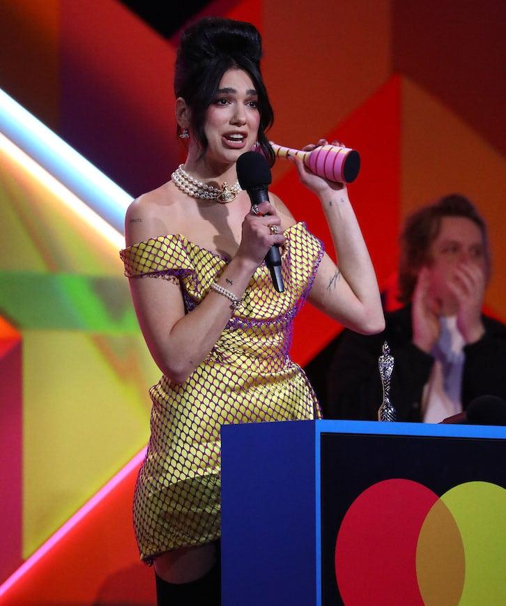 Dua Lipa wears Amy Winehouse's signature beehive hairstyle