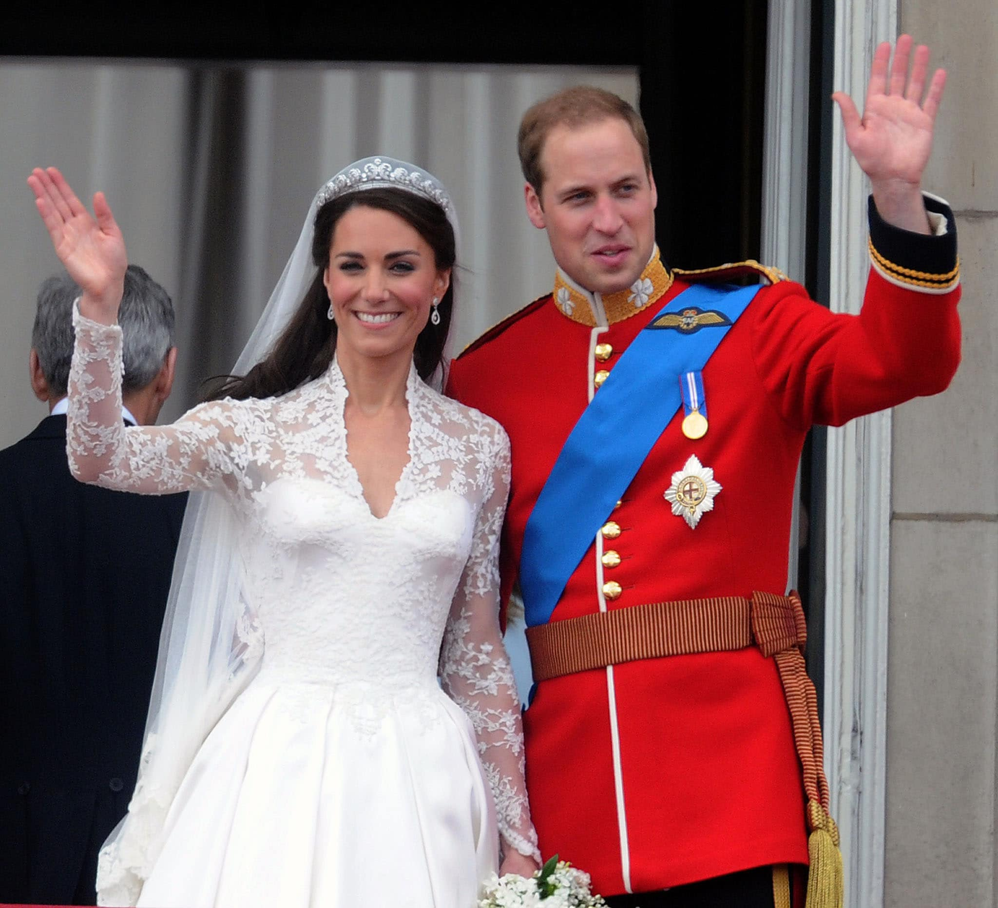 Duchess of Cambridge Kate Middleton wears a white laced wedding gown designed by Sarah Burton for Alexander McQueen in April 2011