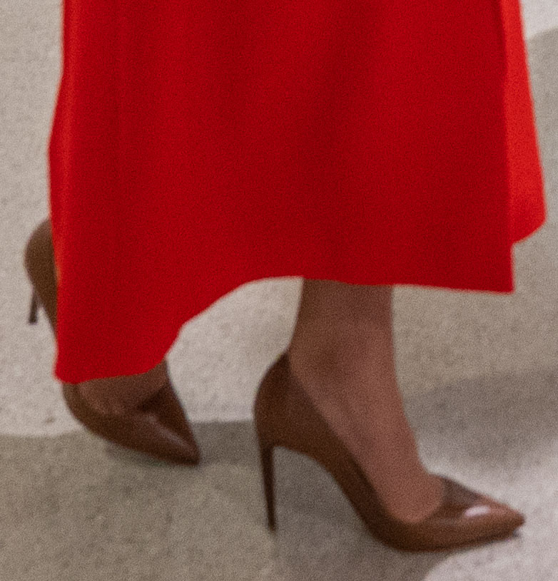 Kate Middleton teams her red coat with brown Ralph Lauren pumps