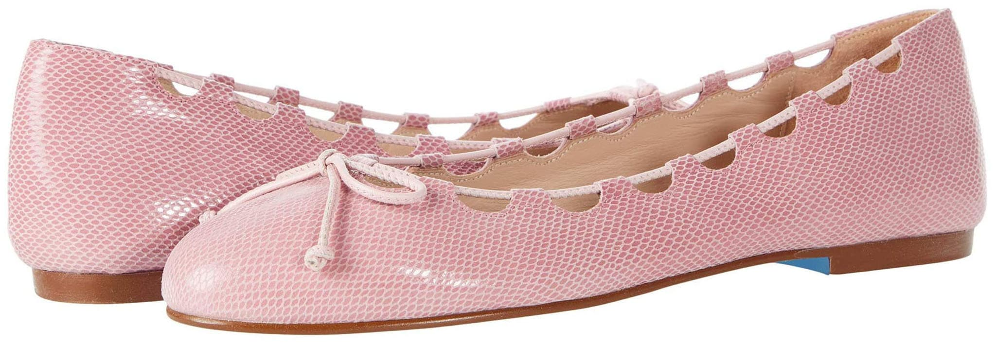 A modern ballet flat made from embossed leather with laced geometric cutouts and bow vamps