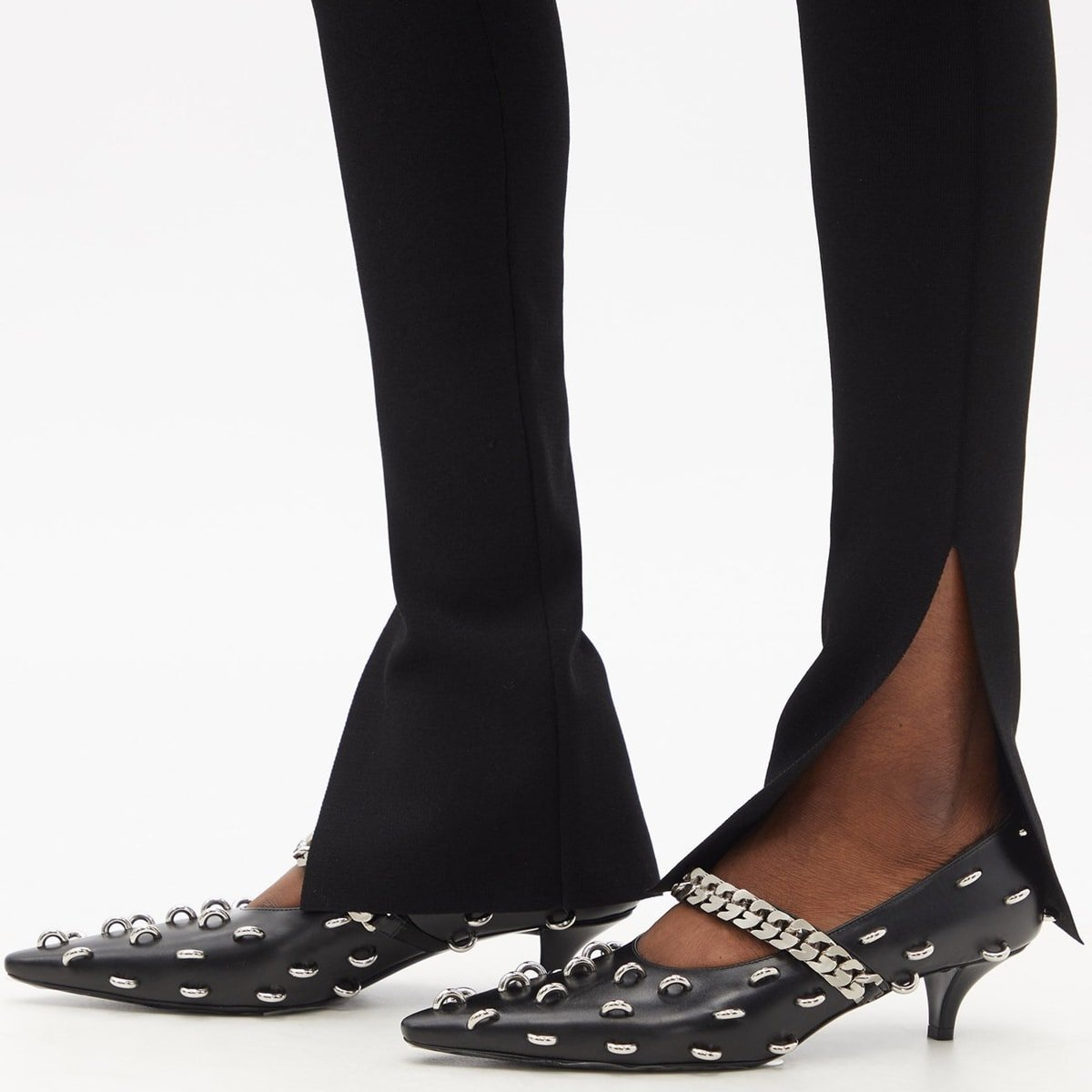 Black kitten heel pumps from Givenchy's Matthew M. Williams embellished with studded rings across the upper