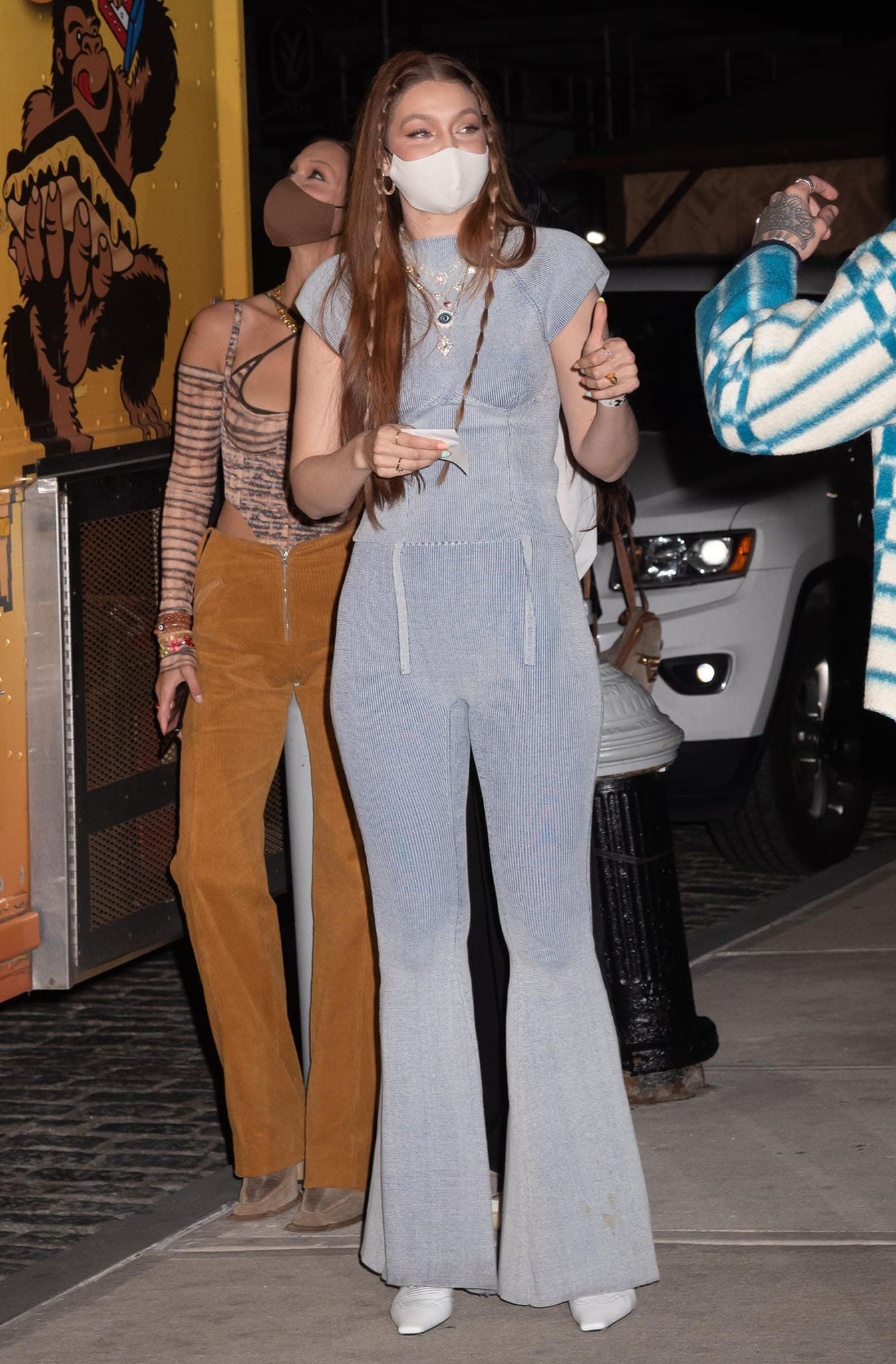 Gigi Hadid goes the '70s route in Isa Boulder rib-knit top and bell-bottom pants