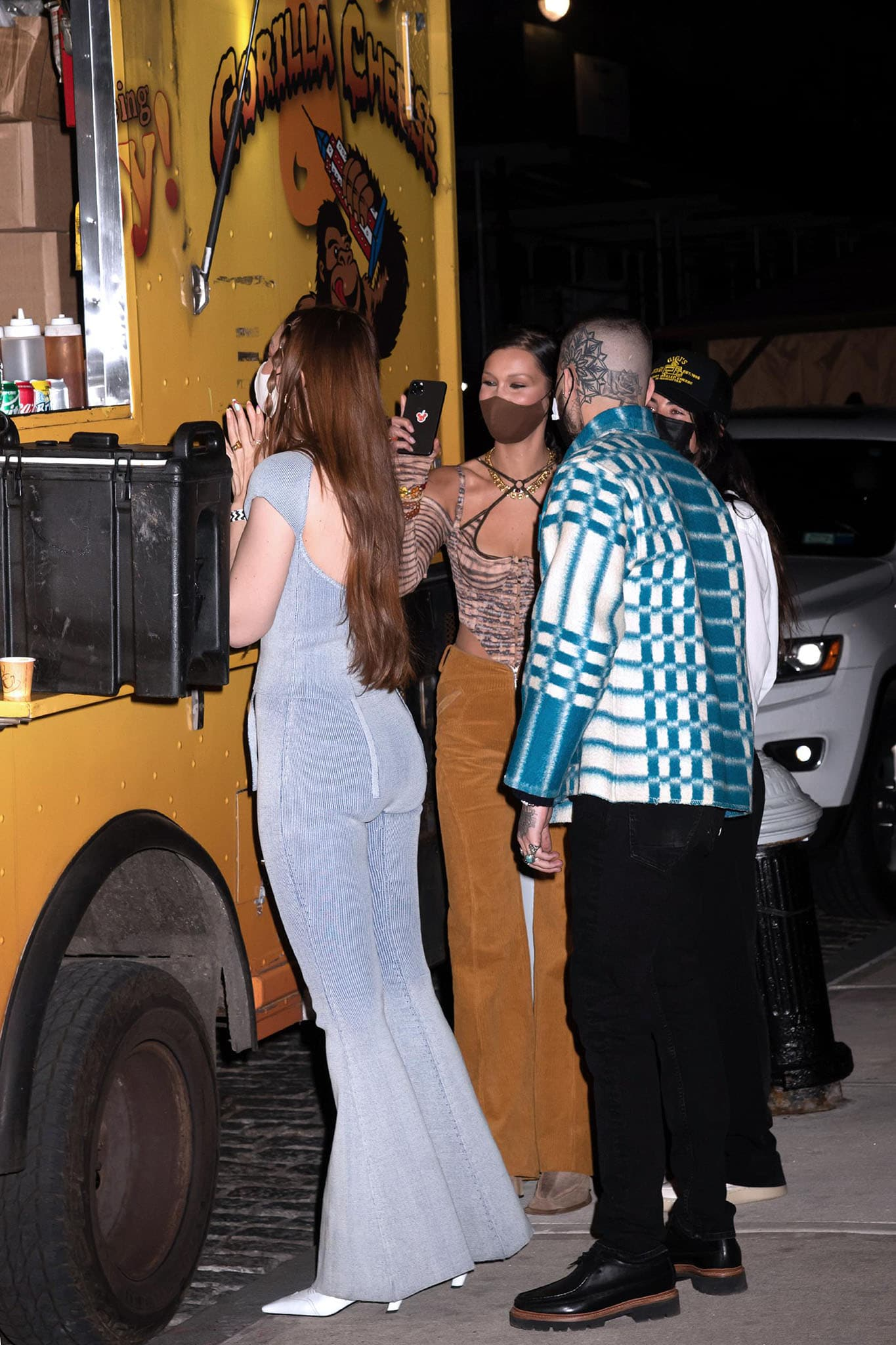 Gigi Hadid celebrates her 26th birthday with a cheese-themed party with boyfriend Zayn Malik and sister Bella Hadid in New York City on April 23, 2021