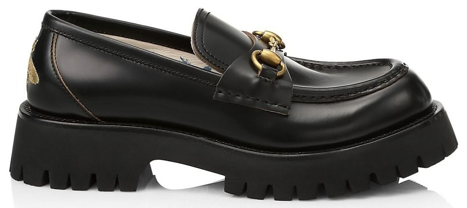 Black leather lug sole loafers with Gucci's distinctive Horsebit motif