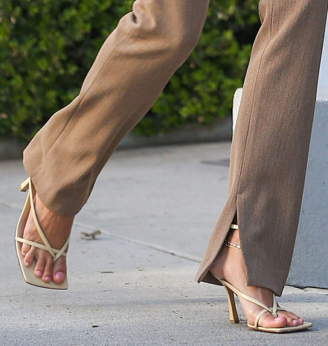 Hailey Bieber wears minimal footwear with Bottega Veneta Stretch Leather nude sandals