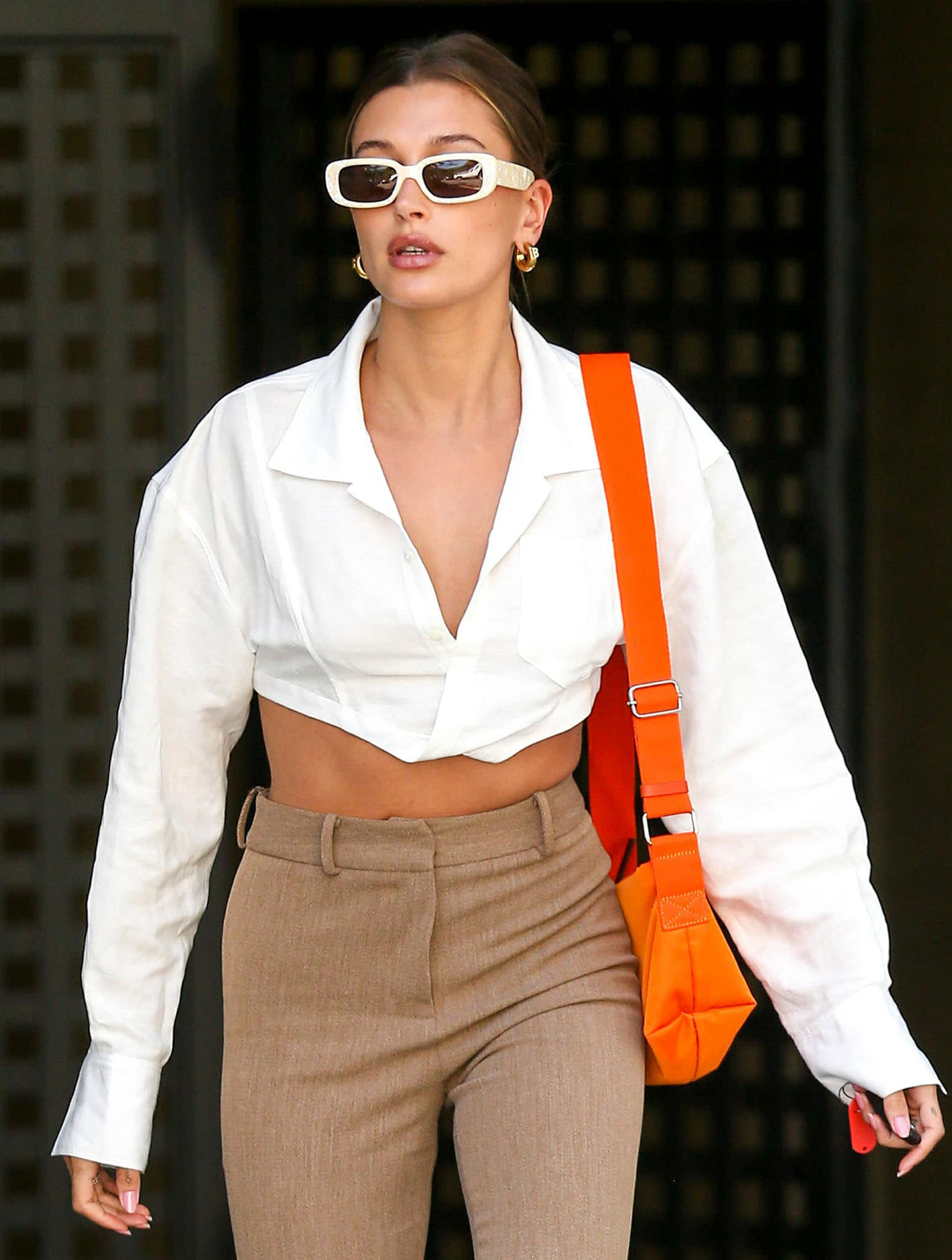 Hailey Bieber adds a retro touch to her business look with cream-framed Reality Eyewear Xray Specs