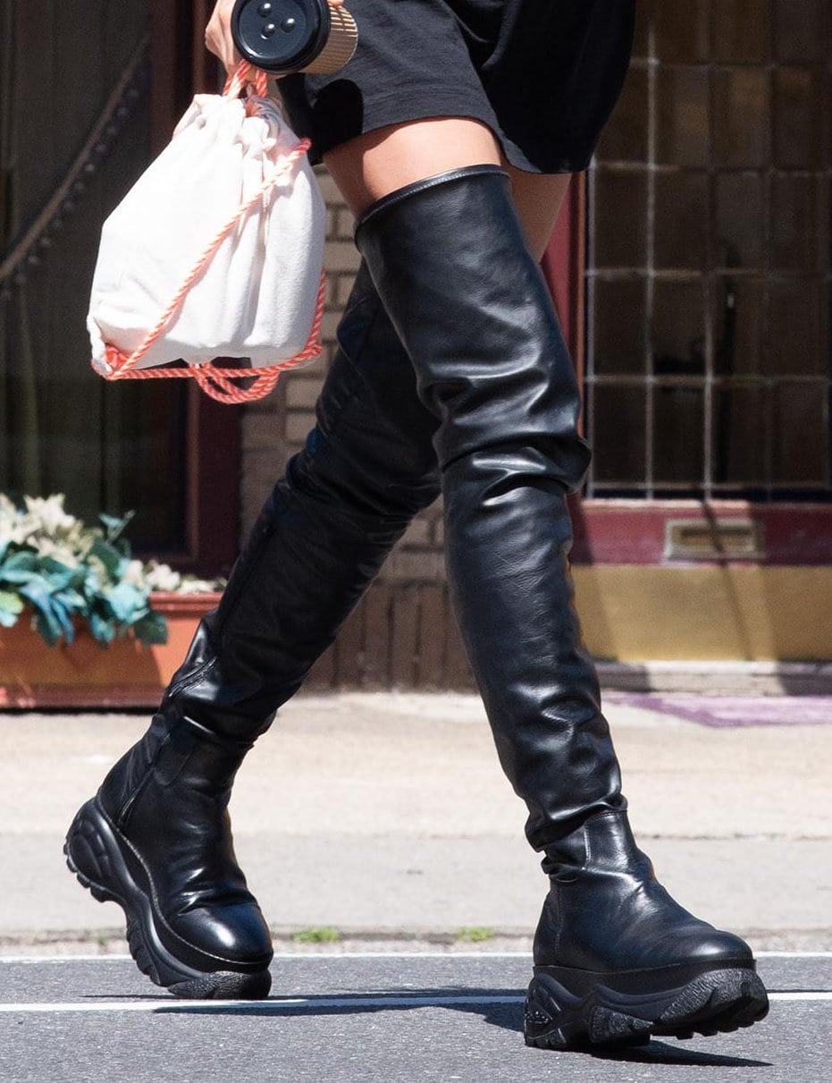 Irina Shayk embraces pantless trend by teaming her sweatshirt with Buffalo by 032C over-the-knee boots