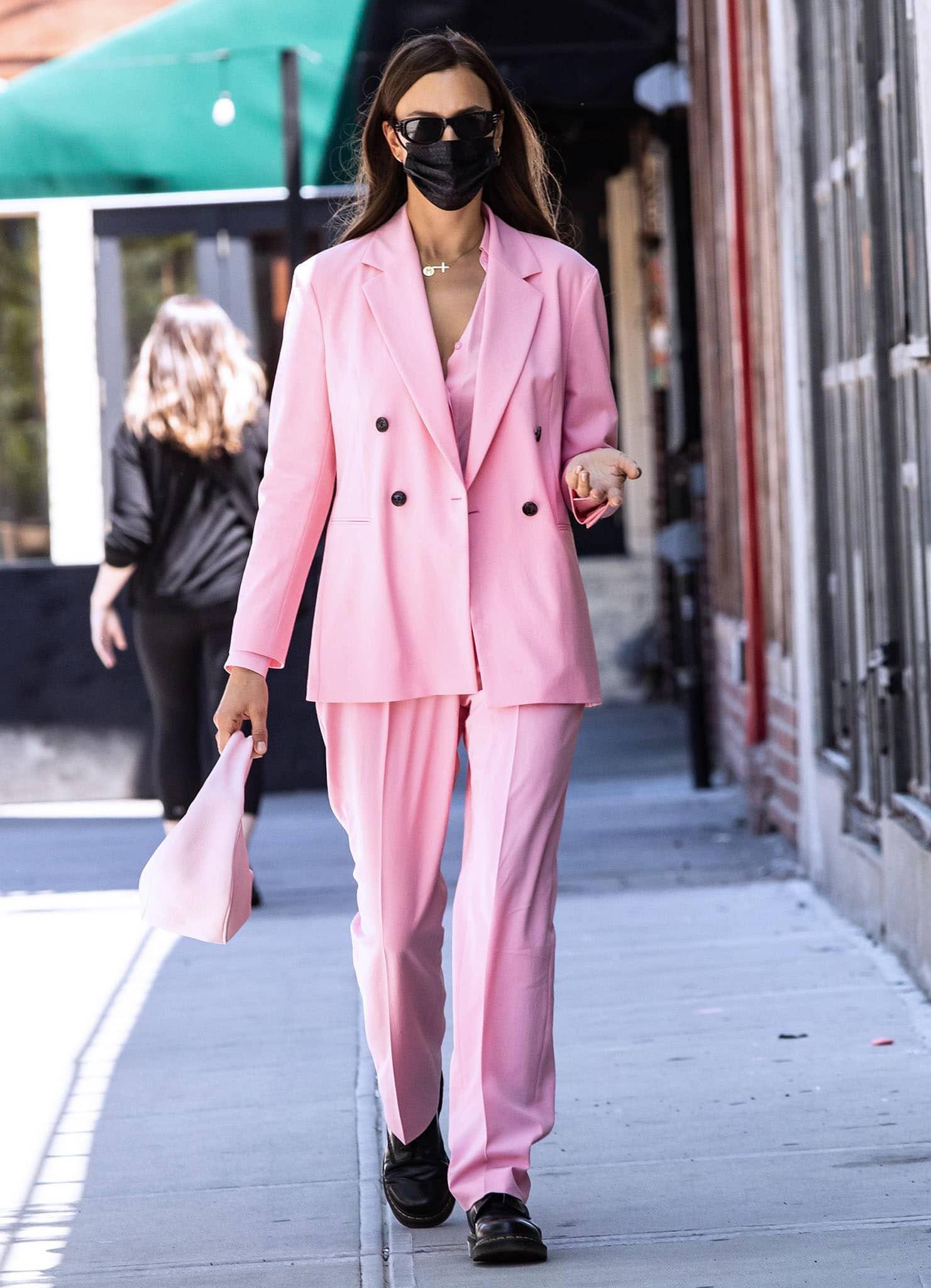 Irina Shayk wears a spring chic bubblegum pink suit from Hugo Boss