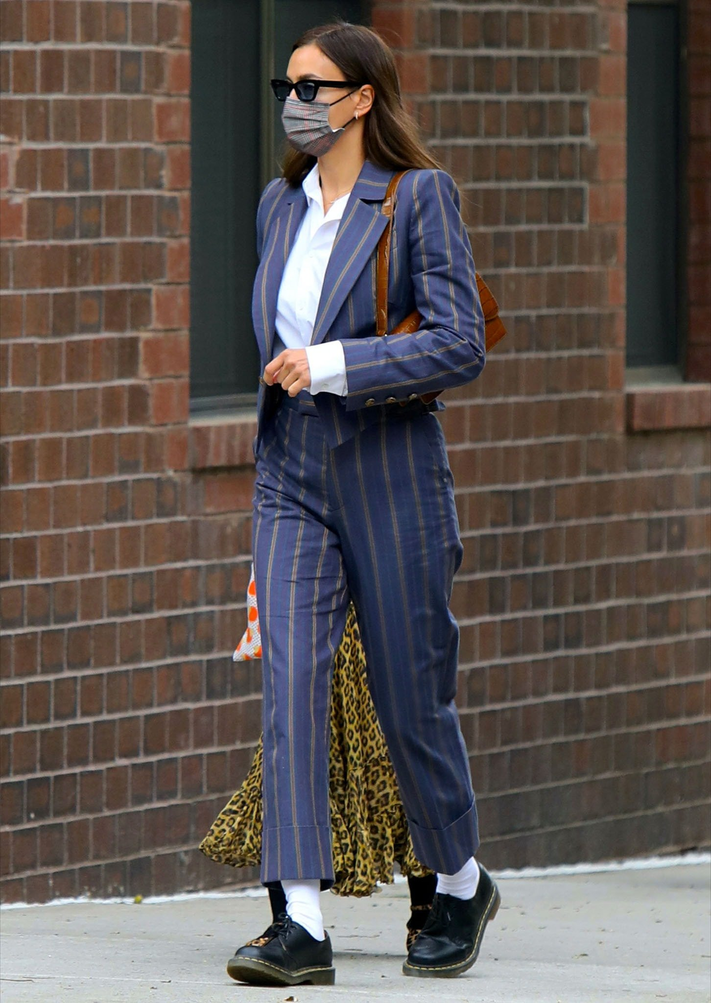 Irina Shayk looks polished in Vivienne Westwood striped suit with crisp white shirt underneath