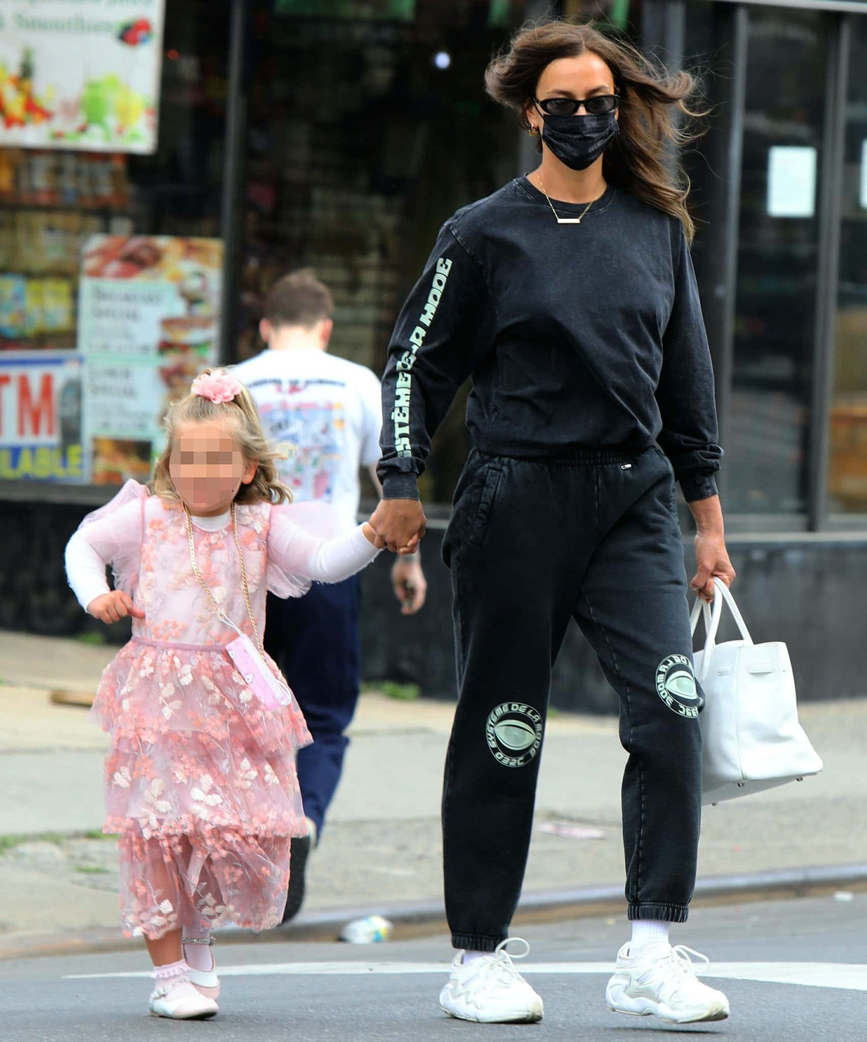 Irina Shayk shows off street style in 032C sweatsuit while Lea dresses up in Self-Portrait pink dress