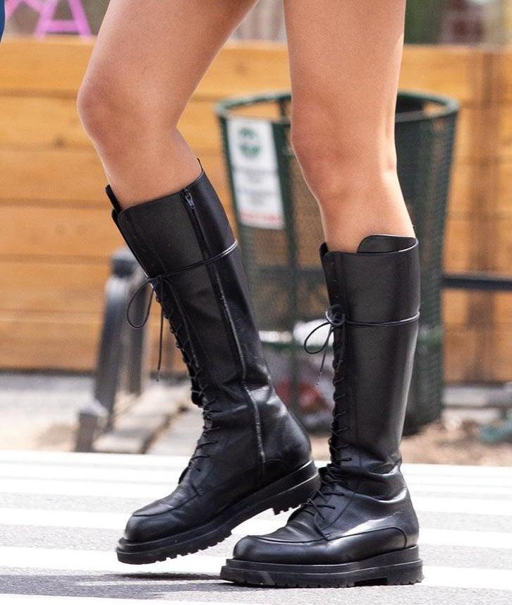 Irina Shayk flaunts her legs in Magda Butrym knee-high combat boots