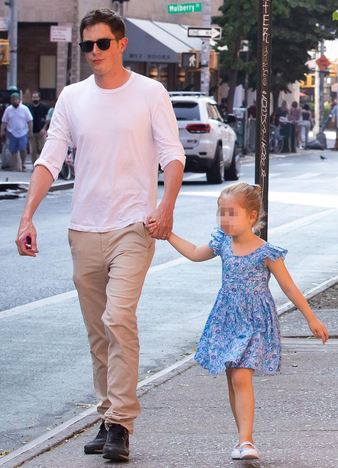James Rothschild keeps it simple in white tee and khaki pants combo as he holds hands with daughter Lily Grace in floral blue dress and matching shoes