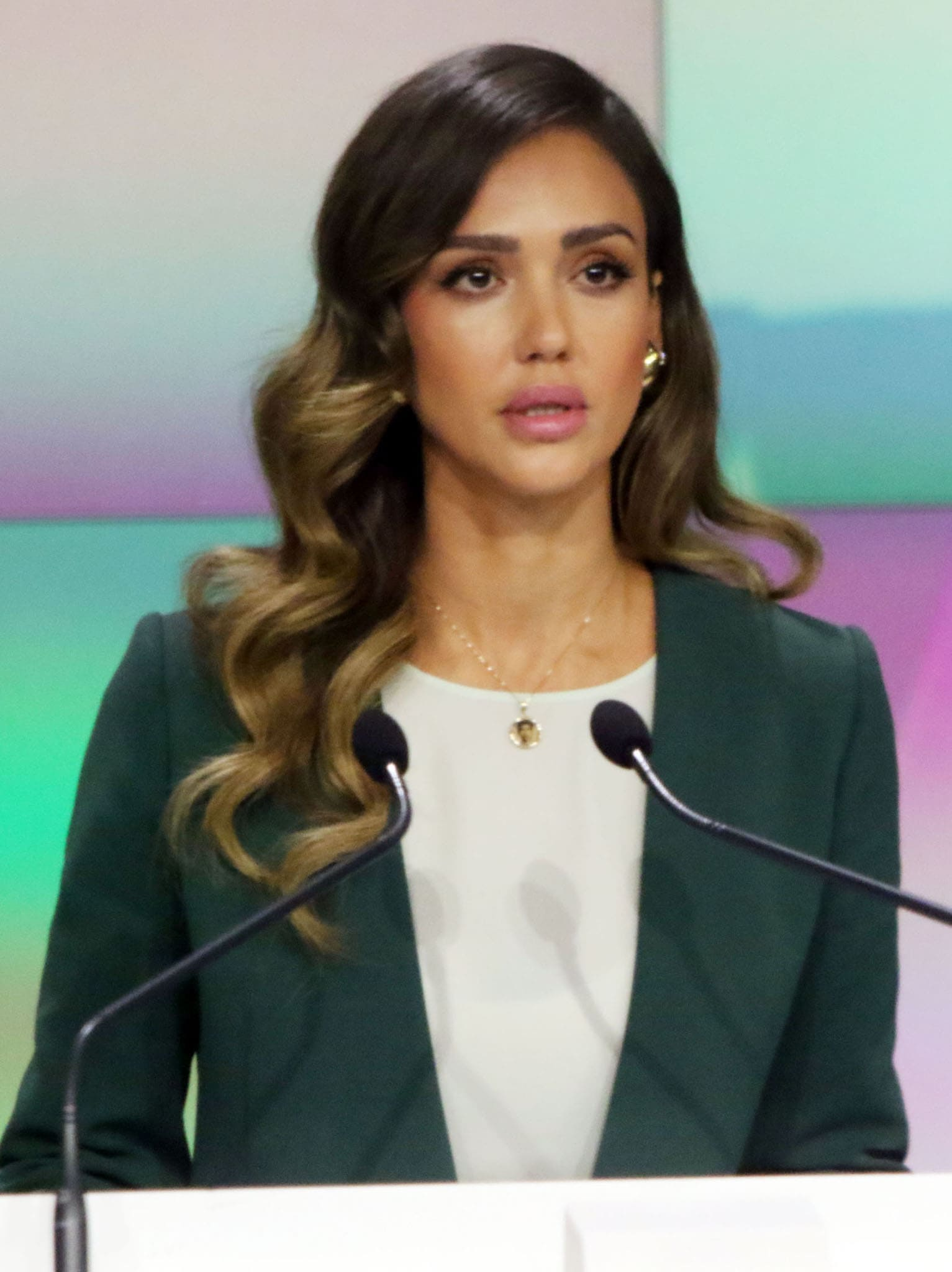 Jessica Alba glams up with side-parted waves, pink blush, pink lipstick, and bold eyebrows