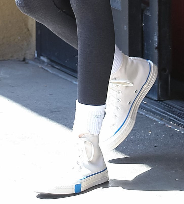 Kaia Gerber completes her athleisure with Set Active white socks and Converse x Undefeated sneakers