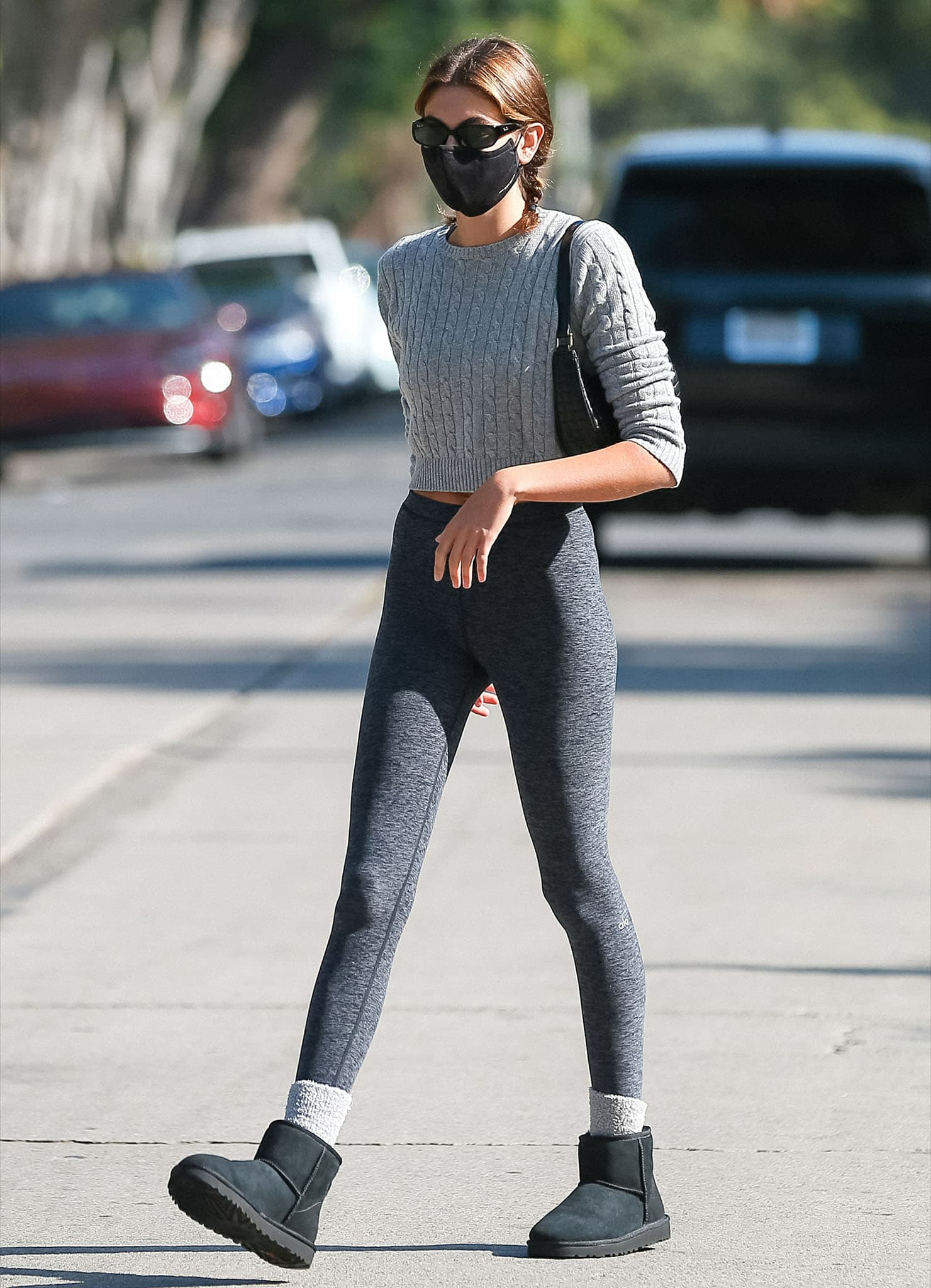 Kaia Gerber leaves Pilates class in Brandy Melville cable-knit sweater and Alo leggings on May 4, 2021