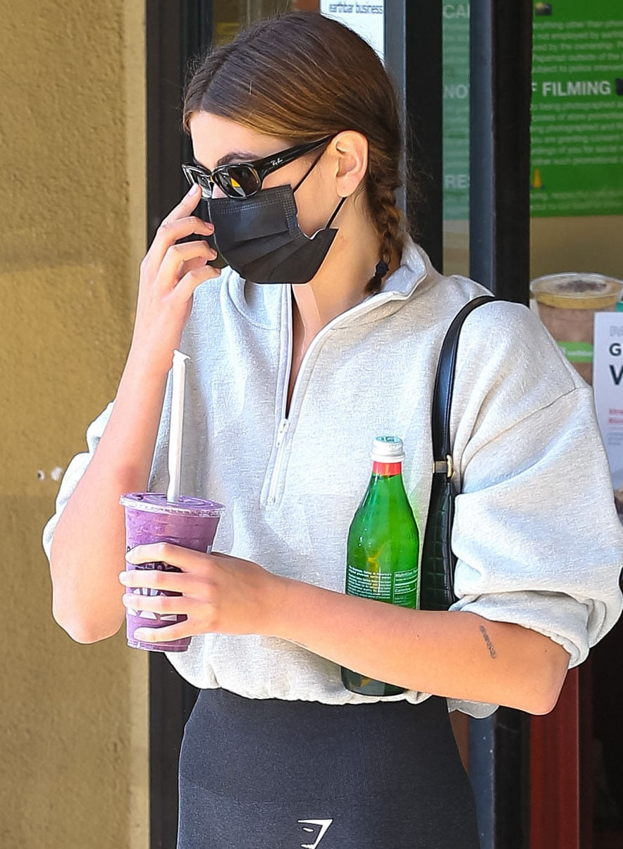 Kaia Gerber accessorizes with Ray-Ban sunglasses and Celine Ava shoulder bag