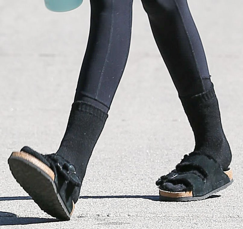 Kaia Gerber teams her Birkenstock Arizona Fur sandals with black socks