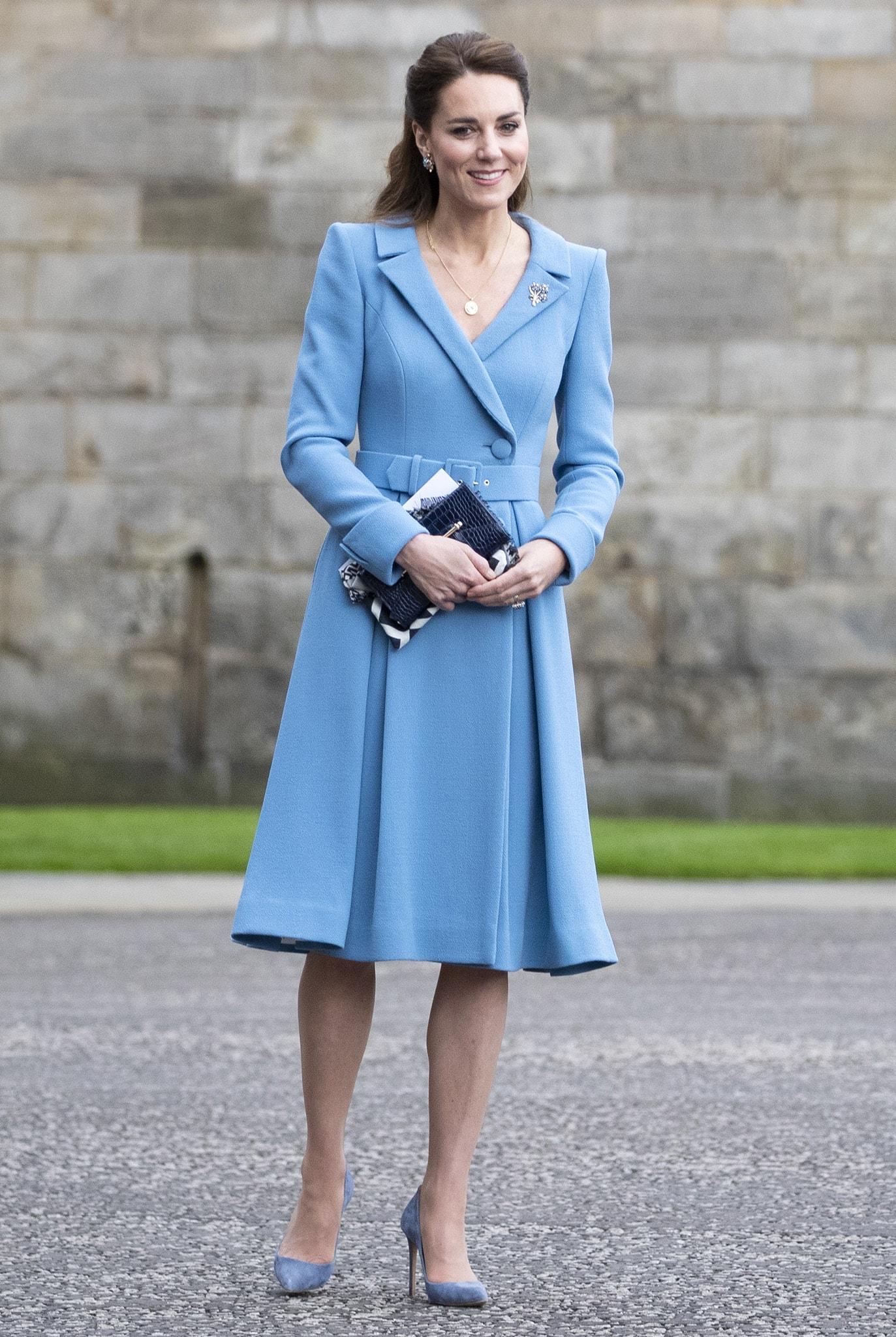 Catherine, Duchess of Cambridge, looks elegant in her Catherine Walker blue coat dress