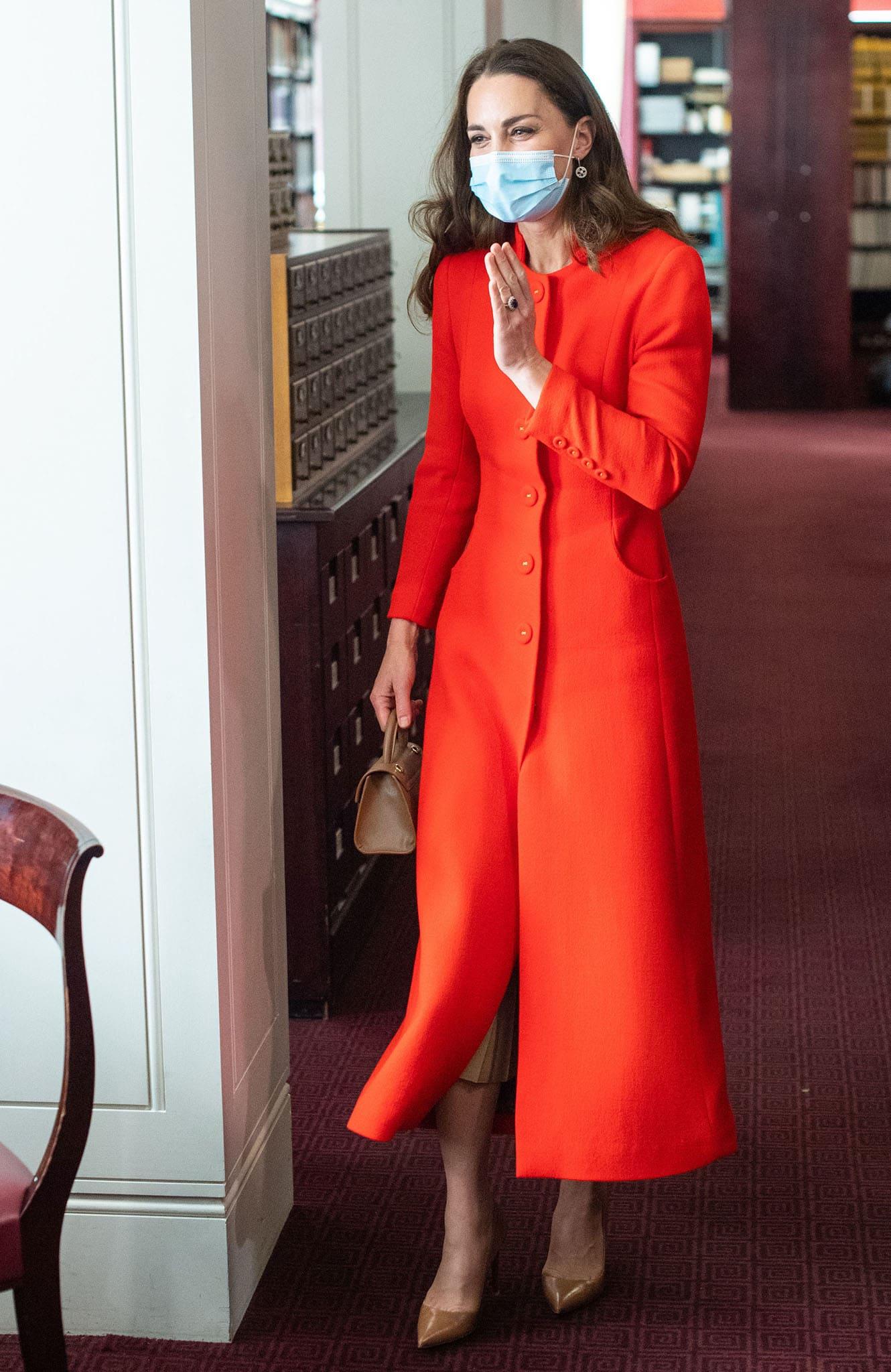 Kate Middleton cuts an elegant figure in Eponine red wool coat and Zara nude midi skirt