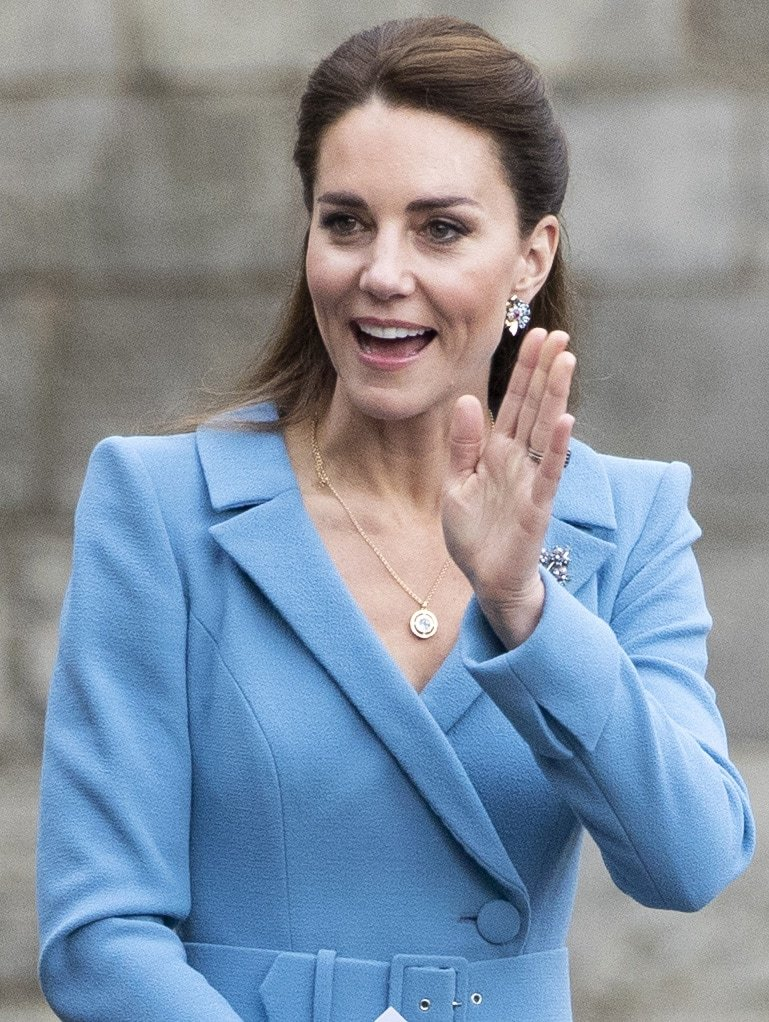Kate Middleton wears simple makeup and sweeps her hair into a half-up, half-down style