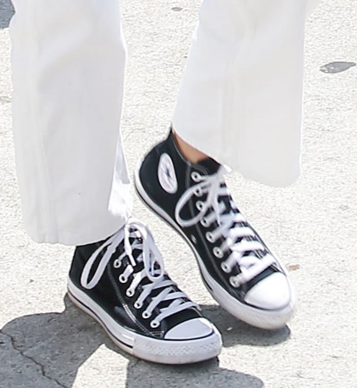 Kendall Jenner stays comfy with a pair of Converse Chuck Taylor Hi sneakers