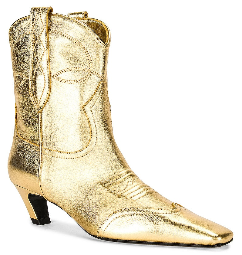 The Khaite Dallas boots feature Western-style stitching on the vamps with square toes and curved kitten heels