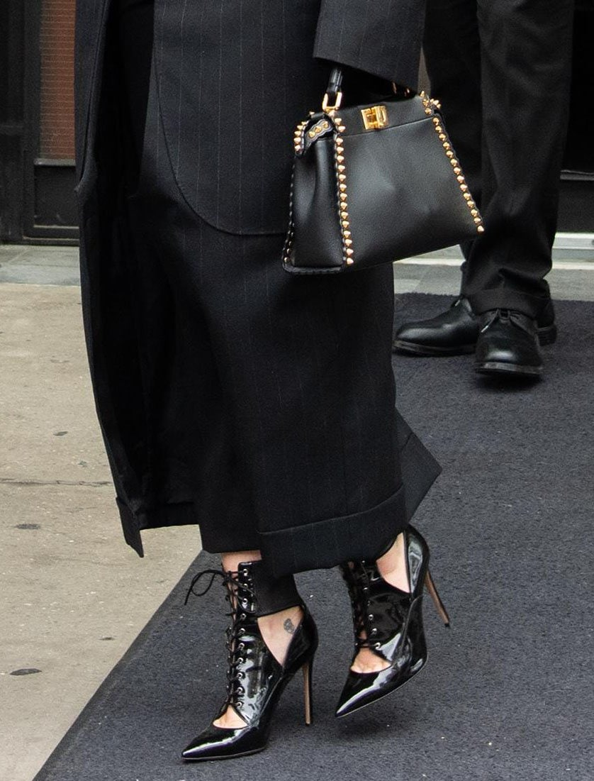 Miley Cyrus finishes off her edgy look with Fendi studded bag and Gianvito Rossi ankle boots