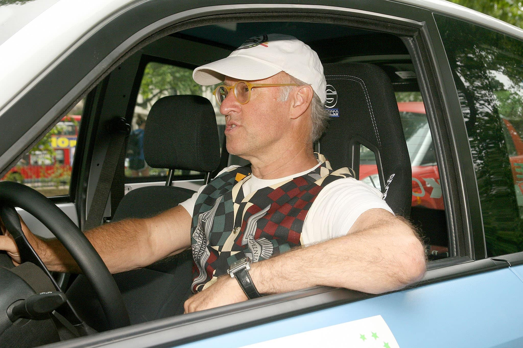 Mulberry founder Roger Saul driving an electric car during the 2010 Brighton to London Eco Rally on July 7, 2010