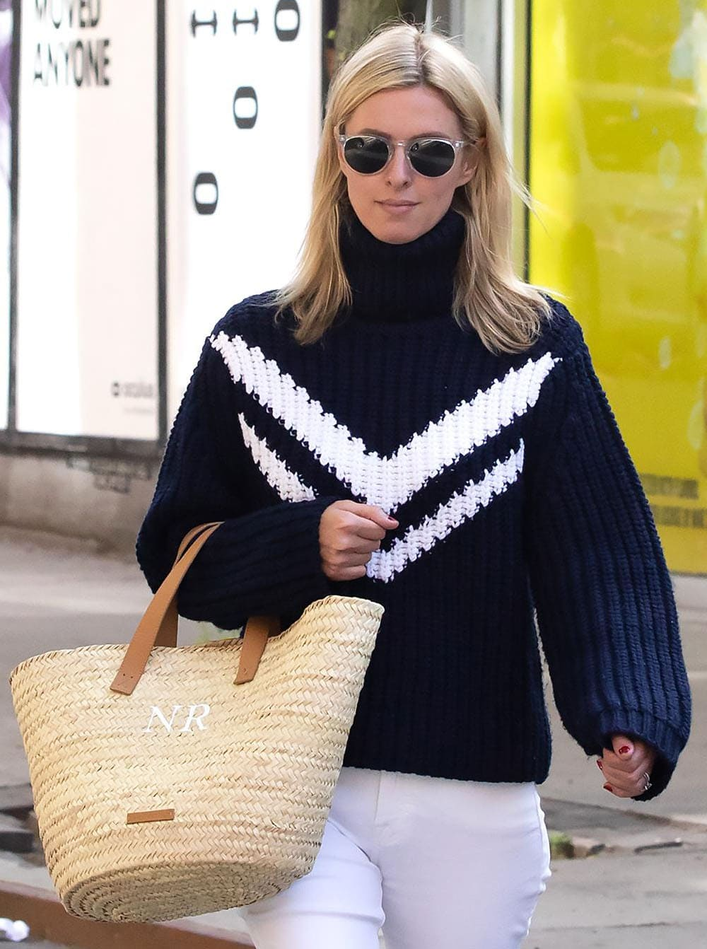 Nicky Hilton hides her eyes behind a pair of Garrett Leight sunglasses and carries a custom large basket woven tote